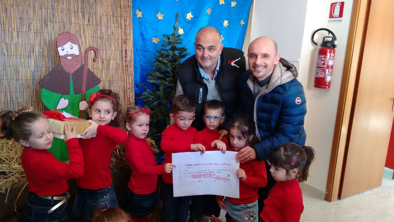 2014_12_19_donazione scuola saracinello